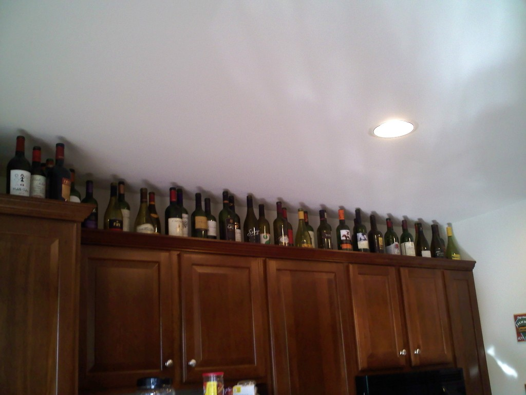 Decorate Top Of Kitchen Cabinets Empty Wine Bottle